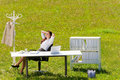 Businesswoman in sunny meadow relax nature office Royalty Free Stock Photo
