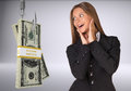 Businesswoman in suprise looking at bundle of money on fish hook on isolated grey background Stock Image
