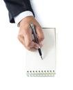 Businesswoman takes notes on paper white background Stock Photos