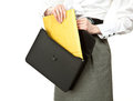 Businesswoman taking letter out of briefcase Stock Photos