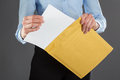 Businesswoman taking letter out of envelope closeup shot Stock Photography