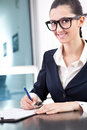 Businesswoman taking notes Royalty Free Stock Photo