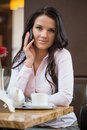 Businesswoman talking on mobile phone in restaurant Royalty Free Stock Photo