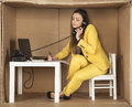 Businesswoman talking on the phone and making notes at one time Royalty Free Stock Photo