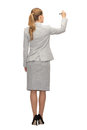 Businesswoman or teacher with marker from back Royalty Free Stock Photo