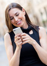Businesswoman texting on her phone Royalty Free Stock Photo