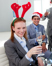 Businesswoman toasting with her colleagues Royalty Free Stock Image