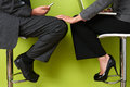 Businesswoman Touching Colleague's Leg Royalty Free Stock Photo