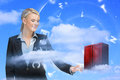 Businesswoman touching data server tower with letters floating on blue sky background Royalty Free Stock Image