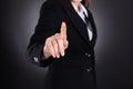 Businesswoman Touching Imaginary Screen