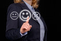 A businesswoman touching touchscreen and giving positive feedback Stock Images