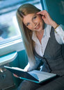 Businesswoman in train Royalty Free Stock Image