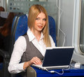 Businesswoman in train Stock Photo