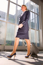Businesswoman with trolley Stock Photo