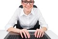 Businesswoman typing on a keyboard white background Royalty Free Stock Image