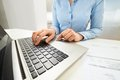 Businesswoman typing on laptop keyboard close up of at desk Royalty Free Stock Photo
