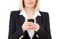 Businesswoman typing a message cropped image of mature holding mobile phone while standing isolated on white Stock Images
