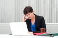 Businesswoman under stress fatigue and headache at office Royalty Free Stock Photos