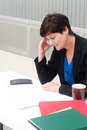 Businesswoman under stress fatigue and headache at office Stock Photos
