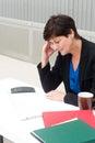 Businesswoman under stress fatigue and headache at office Stock Photos