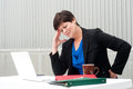 Businesswoman under stress fatigue and headache at office Stock Image