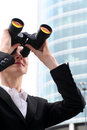 Businesswoman using binoculars Royalty Free Stock Photo