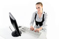 Businesswoman using computer and typing on the keyboard Royalty Free Stock Image