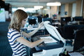 Businesswoman using copy machine in office