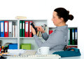 Businesswoman using her smartphone at the workplace Stock Photography