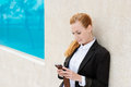 Businesswoman using mobile phone outdoors attractive young in front of her office Stock Photography