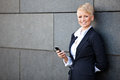 Businesswoman using smart phone Royalty Free Stock Photo