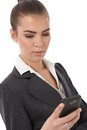 Businesswoman using smartphone Stock Photo