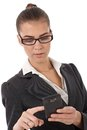 Businesswoman using smartphone Stock Photography