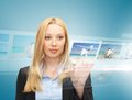 Businesswoman with virtual screen technology internet tv and news concept pressing button on videos Stock Image