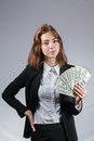 Businesswoman with wad of money in her hands portrait young isolated on white Stock Photography