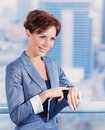 Businesswoman waiting for someone closeup portrait of attractive female wearing elegant suit on cityscape background success Stock Images