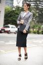 Businesswoman Walking Along Street Royalty Free Stock Photo