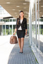 Businesswoman walking in the city with her suitcase Royalty Free Stock Images