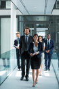 Businesswoman walking with colleagues Royalty Free Stock Photo