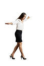 Businesswoman walking on invisible line Royalty Free Stock Photo