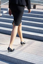 Businesswoman Walking on Stairway Stock Images