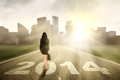 Businesswoman walking to the new year business woman with cityscape background Stock Photography