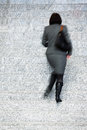 Businesswoman walking up stairs motion blur office worker Stock Photography