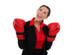 Businesswoman wearing boxing gloves smiling Stock Photo