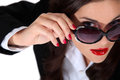 Businesswoman wearing sunglasses styling pair of Stock Photography