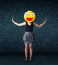 Businesswoman wears yellow smiley face Royalty Free Stock Photo
