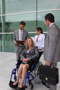Businesswoman in a wheelchair with colleagues Royalty Free Stock Image