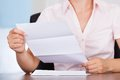 Businesswoman with white envelope closeup of young holding letter Royalty Free Stock Photography
