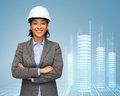 Businesswoman in white helmet with crossed arms building developing consrtuction and architecture concept smiling Stock Photos