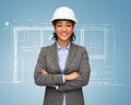 Businesswoman in white helmet with crossed arms building developing consrtuction and architecture concept smiling Royalty Free Stock Photography